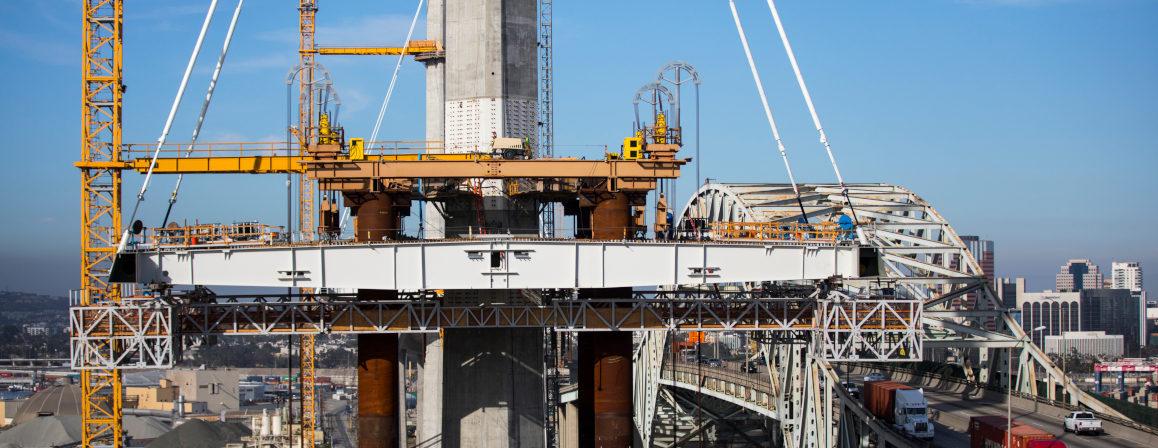 Heavy lift bridge construction wth strand jacks